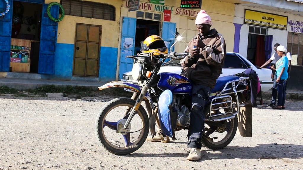 Paul, a porter who also works as a boda-boda driver