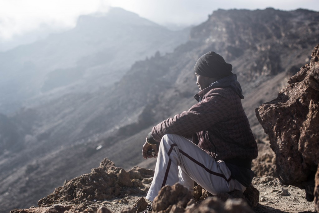 One of my porters, Leonard, above the barren moonscape that is the African alpine zone.