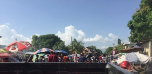 I tried to sneak a picture of the chaotic beauty of a Haitian market
